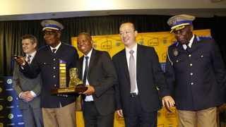Former Joburg Mayor Herman Mashaba with Superintendent Phineas Manyama, who was crowned as Joburg's cop of the year, 2019. Picture: Supplied