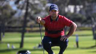 Patrick Reed lines up a putt on the first green during the final round of the Farmers Insurance Open golf tournament at Torrey Pines Municipal Golf Course - South Course. Photo: Orlando Ramirez/USA TODAY Sports via Reuters