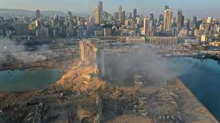 A drone picture shows the scene of an explosion at the seaport of Beirut, Lebanon, on Wednesday. Picture: AP Photo/Hussein Malla