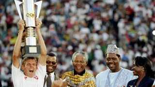 Bafana captain Neil Tovey lifts the Africa Cup Nations trophy and applauded by SA President Nelson Mandela on February 3, 1996. Picture credit: cafonline.com