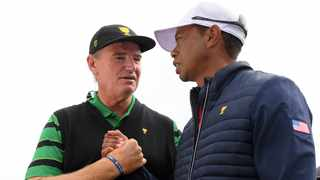 FILE - International team captain Ernie Els, left, shakes hands with U.S. team player and captain Tiger Woods after the U.S. team won the President's Cup golf tournament at Royal Melbourne Golf Club in 2019. Photo: Andy Brownbill/AP Photo