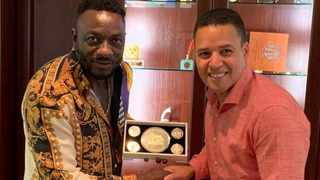 """Zimbabwean socialite and businessman Genius Kadungure with Cape Mint's general manager Howard Steenkamp. The minting company gifted Kadungure with a gold-embossed medal made by its master engravers """"for inspiring hope to young entrepreneurs on the continent"""". Photo supplied"""