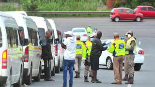 Traffic officers man a roadblock on Mabopane highway to make sure that drivers have the necessary documents and are complying with the lockdown regulations. Picture: Bongani Shilubane/African News Agency (ANA)