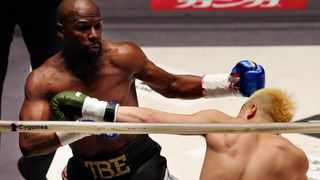 Floyd Mayweather Jr, left, exchanges a punch with Japanese kickboxer Tenshin Nasukawa, during their three-round exhibition match on New Year's Eve in 2018. Picture: Koji Sasahara/AP