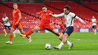 England's Jack Grealish in action with Wales' Connor Roberts during their international friendly match at Wembley Stadium in London on Thursday. Photo: Glyn Kirk/Reuters