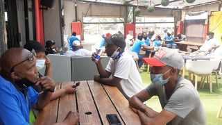 Concerned Tshwane Liquor Traders Association members educate people in a Mamelodi tavern on the concerns surrounding liquor sales. Picture: James Mahlokwane