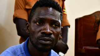 Ugandan presidential candidate Robert Kyagulanyi, also known as Bobi Wine, sits inside the courtroom in Iganga, eastern Uganda. Picture: Abubaker Lubowa/Reuters