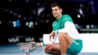 Novak Djokovic celebrates with the trophy after winning his final match against Russia's Daniil Medvedev. Photo: Asanka Brendon Ratnayake