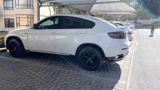 Luxury vehicles were seized by the Assets Forfeiture Unit. They were allegedly bought using unlawful funds from a pyramid scheme operated by Up Money. Picture: Supplied