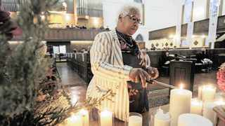 Venetia Orgille lights a candle as a tribute to the late Danny Oosthuizen. People from the streets of Cape Town and supporters form various homeless organizations gathered at Die Groote Kerk in Adderley Street for International Homeless Day. Picture: Armand Hough/African News Agency(ANA)