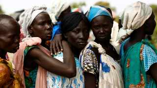 Women wait in line at a UNICEF supported mobile health clinic in the village of Rubkuai, Unity State, South Sudan. Picture: Siegfried Modola/Reuters