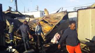 Shack fire leaves 13 families with nothing
