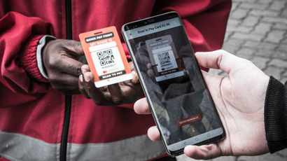 Motorists can now tip petrol attendants by scanning the attendant's QR code