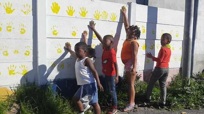 CHANGE: Kids cover hands in paint for the walls. Picture supplied
