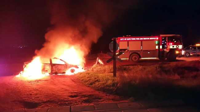 FIERY SCENE: E-hailing taxi service driver's vehicle was bombed in Fisantekraal. Picture: Solly Lottering