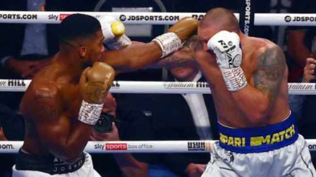 FIGHT: Joshua, left, and champ Usyk