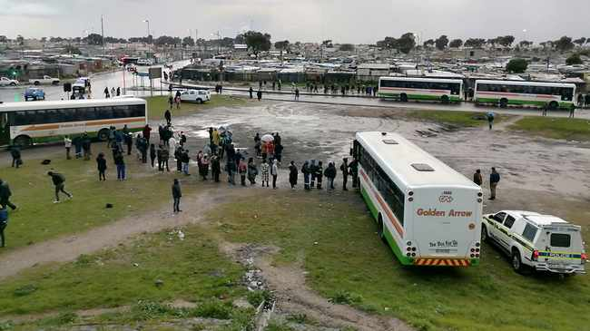 QUEUE: People waiting in line for a seat on Golden Arrow bus. Picture: Ayanda Ndamane