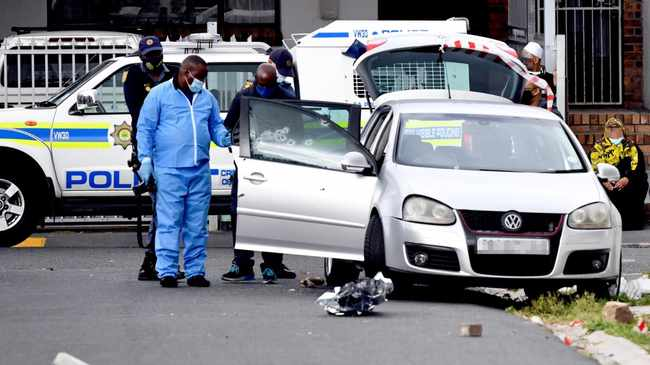 SCENE: Cops inspect VW Golf after the shooting in Wynberg on Friday afternoon. Picture: Leon Knipe