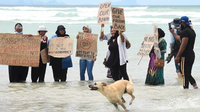 South Africa - Cape Town -30 January 2021 - A group of bathers protesting on the Muizenburg beach,breaking the law and disobeying the Disaster Management Act Level 3 adjusted rules of not being on the beach.Under level 3 no one in South Africa is allowed to be on the beach and public parks because of the spread of the deadly Coronavirus pandemic.The police who were in the vicinity did not act,they allowed and monitored bathers and surfers who were swimming as part of their protest against government to open the beaches and public parks .Photographer:Phando Jikelo/African News Agency (ANA)