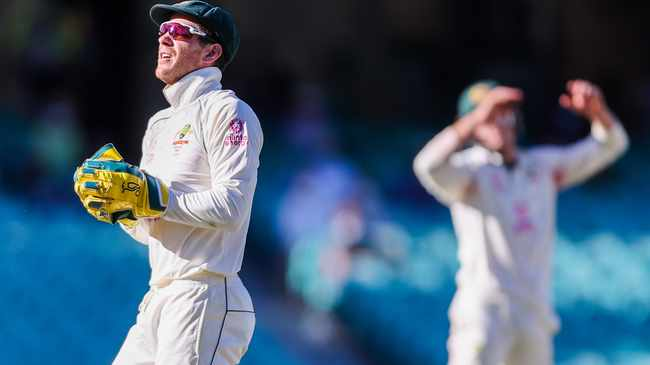 Australia's captain Tim Paine (L) and Marnus Labuschagne react during the fifth day of the third cricket Test match between Australia and India at the Sydney Cricket Ground (SCG) in Sydney on January 11, 2021. (Photo by DAVID GRAY / AFP) / -- IMAGE RESTRICTED TO EDITORIAL USE - STRICTLY NO COMMERCIAL USE --