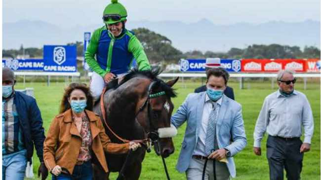 SWEEPING VICTORY: Warrior with jockey Richard Fourie and Justin Snaith, right