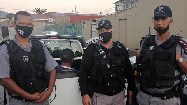 FOILED: Security with the suspect in bakkie.