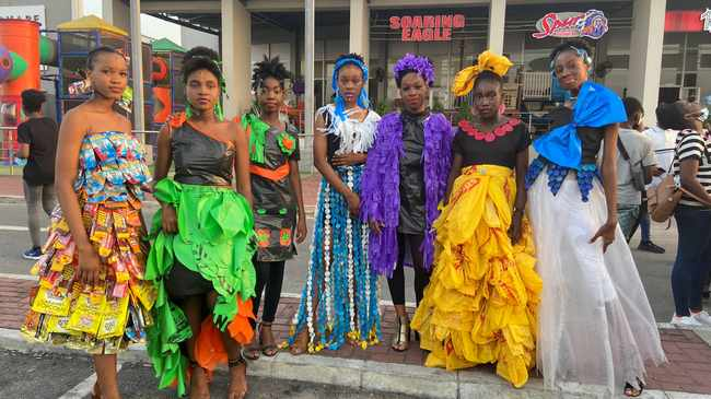 "Young Nigeria climate change activists are seen during a ""Trashion Show"" wearing some plastics recovered from waste, used to make garments during their annual show in Lagos, Nigeria. Picture: Seun Sanni/Reuters"