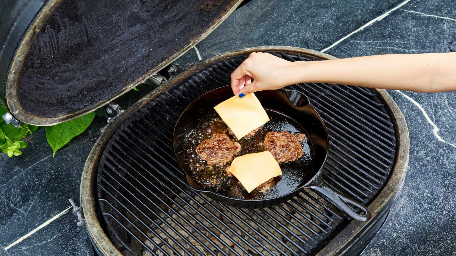 The best way to grill a burger keeps it off the grate
