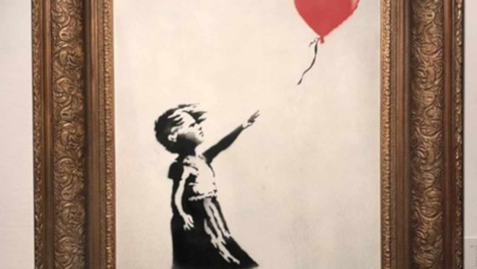 "Banksy's ""Girl With Balloon"" Painting Self-Destructed After It Was Sold For more than R18 million"