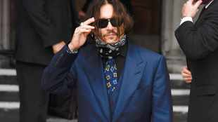 Johnny Depp wrote on wall with blood from finger severed in row, court told