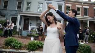 They got married in their street - and the neighbours all came to help