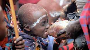 Maasai boys are blessed after passing manhood initiation