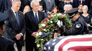 US pays tribute to McCain, Trump absent