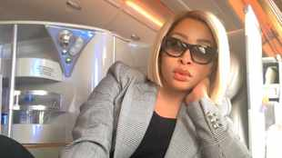Khanyi Mbau reads tweep for flith after coming for her skin