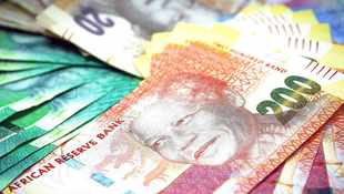 Rand surrenders some gains