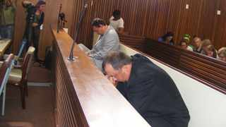 Theo Martins Jackson (right) and Willem Oosthuizen inside the court before they were sentenced. Photo: ANA