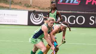 The Madikwe Rangers' Bernie Coston (left) battles the Orange River Rafters' Georgia Grobler for the ball at the Premier Hockey League  at the Randburg Astro in Johannesburg. Photo: Marcel Sigg