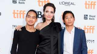 """Maddox Jolie-Pitt, Angelina Jolie and Pax Jolie-Pitt arrive for the screening of """"First They Killed My Father"""". Picture: AP"""