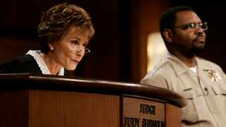 """Judge Judy Sheindlin presides over a case as her bailiff Petri Hawkins Byrd listens on the set of her syndicated show """"Judge Judy"""" at the Tribune Studios in Los Angeles. Picture: AP"""