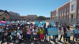 Supporters of a Nigerian pastor who faces charges of human trafficking and rape picket outside the Port Elizabeth Magistrate's Court during an earlier court appearance. Photo / ANA