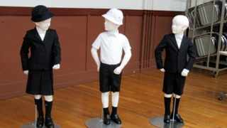 This undated photo provided by Taimei Elementary School shows new school uniforms designed by Italian brand Armani.  The Tokyo public school has adopted expensive Giorgio Armani uniforms for students, triggering criticism in a country where hefty school tuition is already burdening young parents.(Taimei Elementary School via AP)