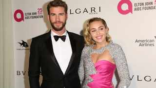 Liam Hemsworth, left, and Miley Cyrus. Picture: Willy Sanjuan/Invision/AP
