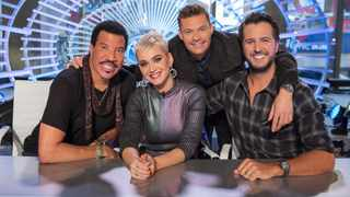 """This image released by ABC shows, from left, Lionel Richie, Katy Perry, Ryan Seacrest and Luke Bryan on the set of """"American Idol"""" in New York. The season premiere had a strong debut on ABC, reaching more than 10 million viewers. (Eric Liebowitz/ABC via AP)"""