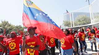 South Africa  - Johannesburg - 16 March 2019 -  Members of the Socialist Revolutionary Workers Party and NUMSA protesting outside the US Embassy in Sandton condemning the US and its allies in the European Union for attempting a coup in Venezuela.  Picture: Simphiwe Mbokazi/African News Agency(ANA).