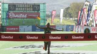 Edward Mothibi is jubilant as he crosses the finish as the winner of the Comrades marathon. Photo: Sibonelo Ngcobo/African News Agency(ANA)