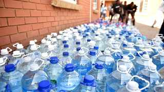 #NotInMyName activists hand over water which is collected to alleviate water problems in Hammanskraal. Picture: Thobile Mathonsi/African News Agency(ANA)