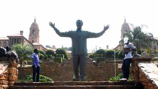 Photographers who photograph tourists with the Mandela statue at the Union Buildings waits for customers, due to the coronavirus strict travel restrictions have been introduced. Picture: Jacques Naude/African News Agency(ANA)