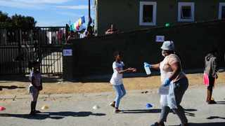 SOUTH AFRICA - Cape Town - 9 April 2020. Day 14 of the National Lockdown. Learners at Trevor Manual Primary school in Fisantekraal near Durbanville receive food parcels. The school provides 1500 meals a day, which is part of the Emergency School Feeding programme which started around the Western Cape on 8 April 2020. The Western Cape Provincial Treasury approved the allocation of R53 million additional funding for emergency food relief programmes which will run across the Western Cape. R18 million to the Department of Education to initiate a special school feeding programme from 8 April until 20 April, which will target the 485 000 existing school feeding scheme beneficiaries with one takeaway meal a day at approximately 1 000 schools. Picture Henk Kruger/African News Agency (ANA).
