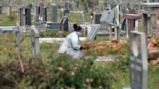 A woman visits the grave of a loved one at Eersterust Cemetery on day 17 of South Africa's five-week lockdown aimed at curbing the spread of Covid-19. File photo: Oupa Mokoena/African News Agency  (ANA)