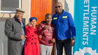 (From left) ward councilor Willie Jaftha with beneficiaries Cathleen and Fred Swanepoel and the City of Cape Town's Mayoral Committee Member for Human Settlements Malusi Booi. PHOTO: Supplied